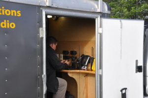 Ian VE7HHS operating the radios in the trailer.